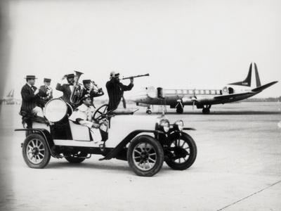 A Vintage Car with a Welcoming Band at the Airport