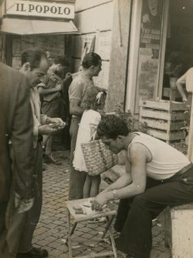 Man Sitting in Front of a Fruit Shop by Luigi Leoni