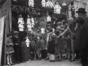 Puppeteer with Several Pulcinella Puppets by Luigi Leoni