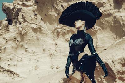 Female Model Wearing Black with Feathers by Luis Beltran