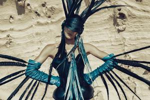 Female Model Wearing Feathers by Luis Beltran