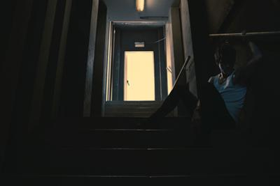 Young Man Posing in Dark Setting by Luis Beltran