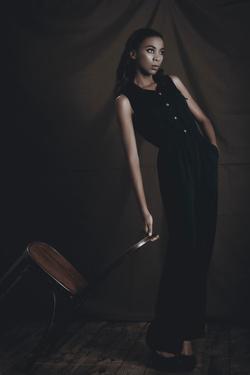 Young Woman Posing in Studio by Luis Beltran