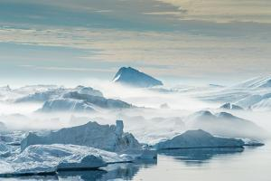 Huge Stranded Icebergs at the Mouth of the Icejord Near Ilulissat at Midnight, Greenland by Luis Leamus