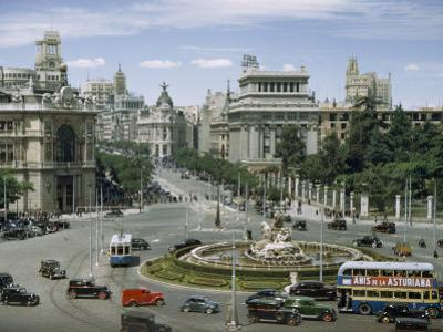 Traffic Swirls around the Cybele's Fountain in Central Madrid