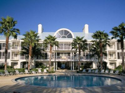 https://imgc.allpostersimages.com/img/posters/luxury-seafront-apartments-seven-mile-beach-grand-cayman-cayman-islands_u-L-P1THMI0.jpg?p=0