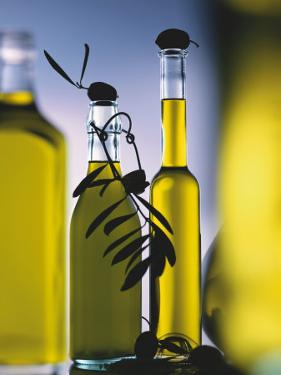 Olive Oil in Bottles by Luzia Ellert