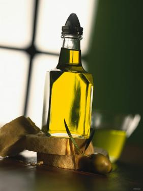 Olive Oil with Slices of Bread by Luzia Ellert