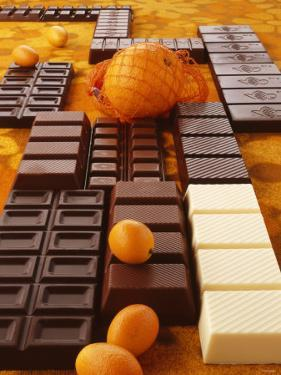 Still Life of Chocolate Bars and Citrus Fruit by Luzia Ellert