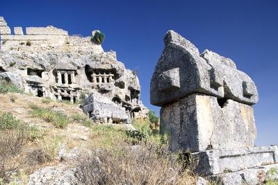 https://imgc.allpostersimages.com/img/posters/lycian-sarcophagus-and-ottoman-fortress-with-rock-tombs-tlos-antalya-turkey_u-L-PP6OZN0.jpg?p=0