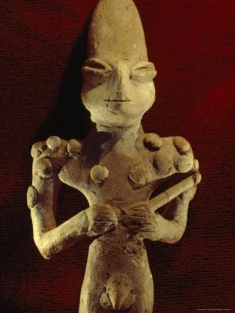 A Ubaid Terra-Cotta Fiqure Dating from 3500 B.C. by Lynn Abercrombie
