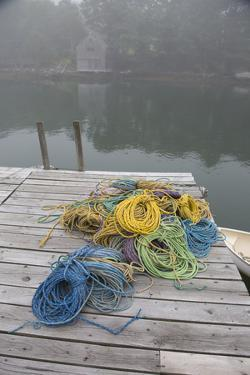 Dock, Lobster Trap Roping, and Boathouse in Fog, New Harbor, Maine, USA by Lynn M^ Stone