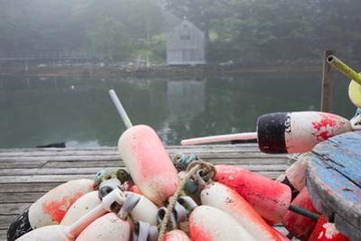 Lobster Trap Buoys and Distant Bdoathouse in Fog, New Harbor, Maine, USA by Lynn M. Stone