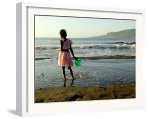 A Girl Walks on the Beach in Jacmel, Haiti, in This February 5, 2001 by Lynne Sladky