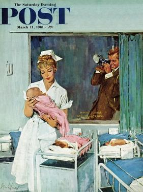 """Father Takes Picture of Baby in Hospital,"" Saturday Evening Post Cover, March 11, 1961 by M. Coburn Whitmore"