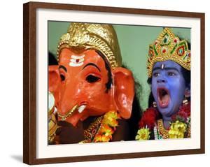 A Child Dressed as Hindu God Krishna Yawns, Chennai, India, September 22, 2006 by M. Lakshman