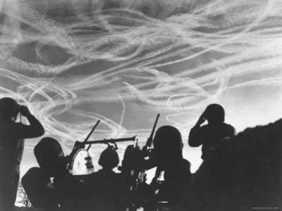 Alerted GIs of M 51 Anti Aircraft Battery Silhouetted Against German