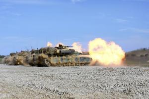 M1A1 Abrams Fire their 120Mm Smoothbore Cannon