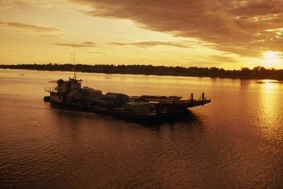 A Barge on Amazon River at Iquitos at Sunrise by Macduff Everton