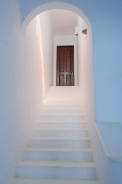 A White, Arched Stairway Leads to a Closed Hotel Door by Macduff Everton