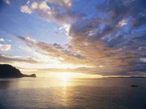 Boating Under Sunset in the Gulf of Nicoya by Macduff Everton