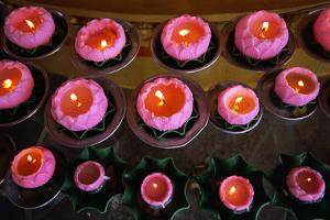 Burning Candles in Buddhist Temple by Macduff Everton