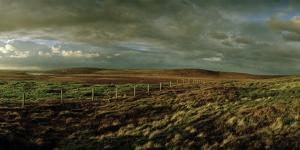 Fenced Moorland under a Dramatic Sky by Macduff Everton