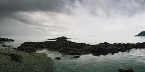 Rocks Line the Beach on the Coast Near Uwajima by Macduff Everton