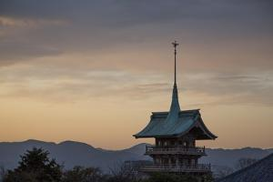 The Top Section of a Pagoda and Distant Mountains at Sunset by Macduff Everton