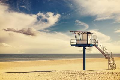 Vintage Retro Style Filtered Picture of a Lifeguard Tower on a Beach.
