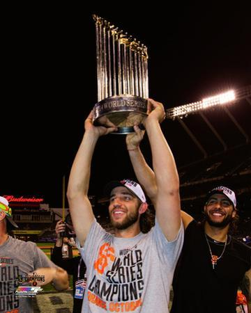 Madison Bumgarner with the World Series Championship Trophy Game 7 of the 2014 World Series