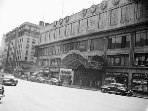 Madison Square Garden with Automobiles on Street