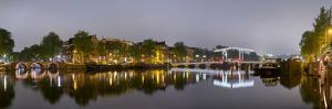 Magere Brug over the River Amstel and Canal Houses Illuminated on Foggy Evening