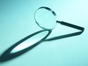 Magnifying Glass on Its Side with Shadow in Blue Light