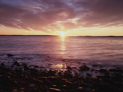 https://imgc.allpostersimages.com/img/posters/maine-sunrise-over-the-rocky-shoreline-of-the-atlantic-ocean_u-L-PU3HO30.jpg?artPerspective=n