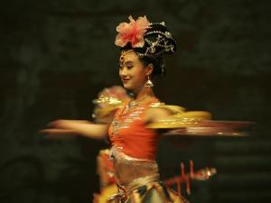 Mainland China Dance Group Perform an Arrangement Depicting Buddhist Imagery Found in the Grottoes