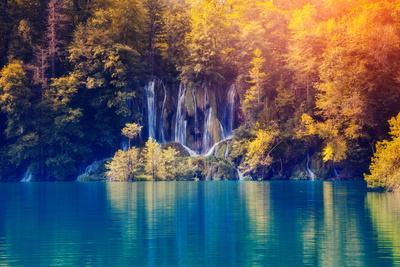 https://imgc.allpostersimages.com/img/posters/majestic-view-on-waterfall-with-turquoise-water-and-sunny-beams-in-plitvice-lakes-national-park-fo_u-L-Q105K2O0.jpg?p=0