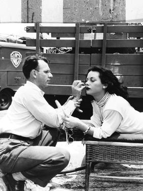 Makeup Artist Ben Nye Applying Eye Makeup to Actress Hedy Lamarr Who Observes in a Mirror