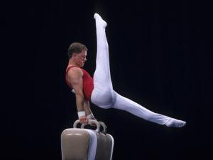Male Gymnast Performing on the Pomell Horse
