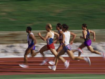 Male Runners Competing in a Track Race