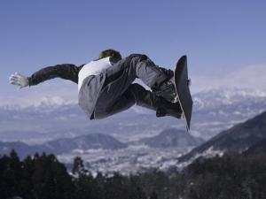 Male Snowboarder Flying over the Vert