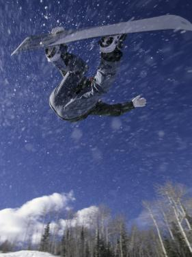 Male Snowboarder Flying Throught the Air, Aspen, Colorado, USA