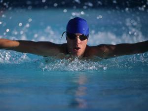 Male Swimmer Competing in Abutterfly Race