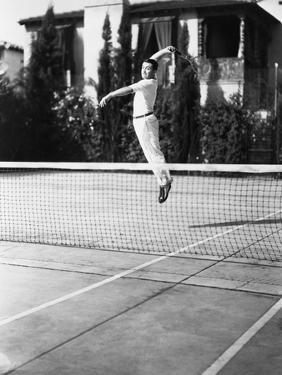 Male Tennis Player Jumping for Shot