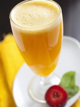 A Glass of Orange Juice by Malgorzata Stepien