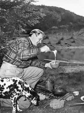 Man and His Dog Camping and Preparing Food