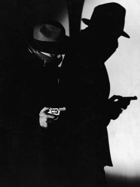 Man Dressed As Gangster With Gun, and His Shadow