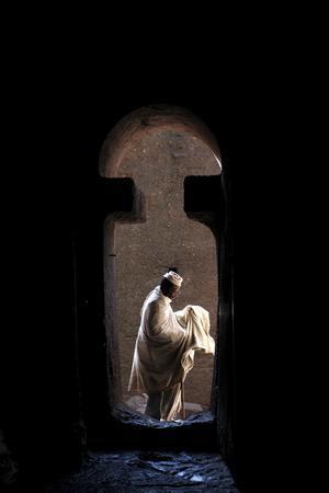 https://imgc.allpostersimages.com/img/posters/man-entering-bet-medhane-alem-church-in-lalibela-wollo-ethiopia_u-L-Q1GYKYG0.jpg?artPerspective=n