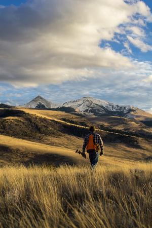 https://imgc.allpostersimages.com/img/posters/man-hikes-while-upland-bird-hunting-in-montana_u-L-Q1BARK30.jpg?p=0