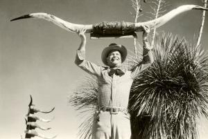 Man Holding Longhorns
